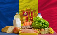 basic food groceries in front of andorra national flag - stock photo