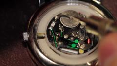 someone is changing a wristwatch batterie - stock footage