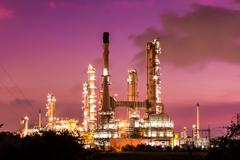 oil refinery plant and smoke at twilight morning - stock photo