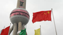Shanghai Oriental Pearl TV Tower and China National flag Stock Footage