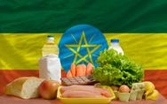 Basic food groceries in front of ethiopia national flag Stock Photos