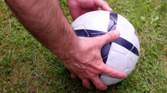 detail soccer player kicking ball on field - stock footage