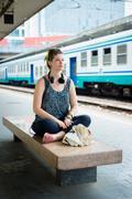 Beautiful stylish modern young woman waiting train Stock Photos
