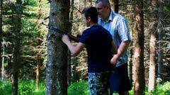 Father and son with optical rifle in the woods episode 2 Stock Footage