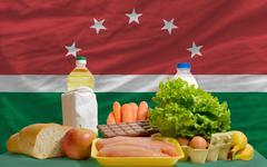 basic food groceries in front of maghreb national flag - stock photo