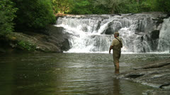 Trout Fishing at Waterfall Stock Footage