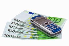 Banknotes and cellular telephone Stock Photos