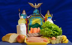 basic food groceries in front of new york us state flag - stock photo
