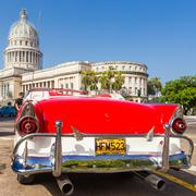 classic ford near the capitol in havana - stock photo