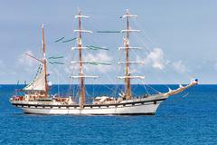 sailing ship on a calm blue sea - stock photo