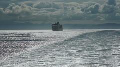 Cruise ship following Alaska sunset HD 7859 Stock Footage
