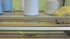 Bobbin runs on working weaving loom Stock Footage