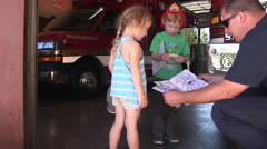 children visit fire station, fireman - stock footage
