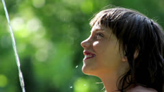 Boy playing with water in the garden,boy washing his face Stock Footage