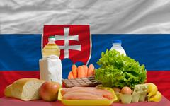 basic food groceries in front of slovakia national flag - stock photo