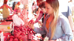Young Asian Woman Buying Peaches at Farmers Market Stock Footage