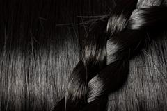 beautiful black hair with braid - stock photo