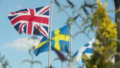 The flags of England, Sweden and Finland. - stock footage