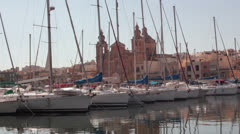 Maltese impressions - shipyard with church in the background Stock Footage