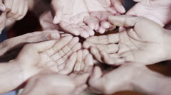 Many hands reaching out, begging for food or money - stock footage