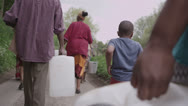 Stock Video Footage of African villagers travel together to find water
