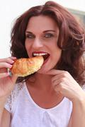 Delicious croissant with a pretty woman to attach Stock Photos