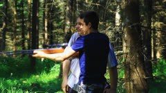 Father and son with optical rifle in the woods episode 4 Stock Footage
