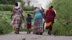 African villagers travel together to find water - stock footage