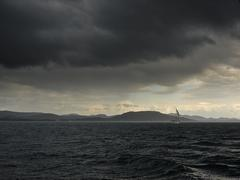 Storm. islands and sailing boat Stock Photos