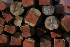 Structure of red stacked wood boards. Stock Photos