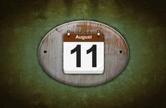 Stock Illustration of old wooden calendar with august 11.