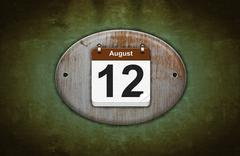 Old wooden calendar with august 12. Stock Illustration