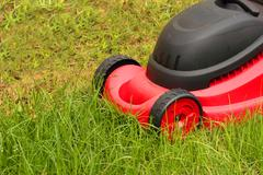 lawnmower mowing the grass - stock photo