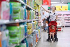 Mother with her boy in the supermarket Stock Photos