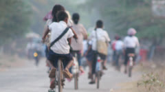 Children riding to school in Cambodia Stock Footage