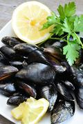 Stock Photo of lemon and mussels raw