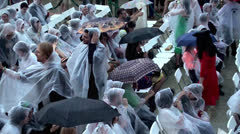 People in the rain in an open-air cinema Stock Footage
