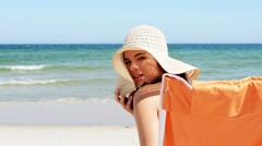 Attractive cheerful summer woman at the beach. Stock Footage