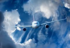 passenger airliner in the sky - stock photo