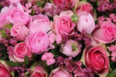 mixed pink flower arrangement - stock photo