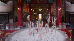 Burning incense chinese temple Stock Footage
