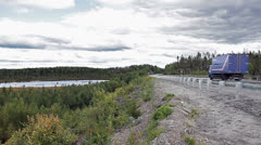 Karelian road between evergreen forests, lakes and rivers Stock Footage