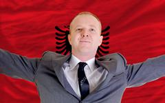 Happy businessman because of profitable investment in albania Stock Photos