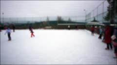 People skating on ice-rink, defocused Stock Footage