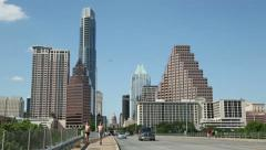 Traffic and joggers cross s congress avenue bridge, Austin Stock Footage