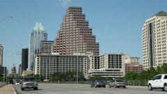 Traffic crosses s congress avenue bridge with austin skyline in background Stock Footage