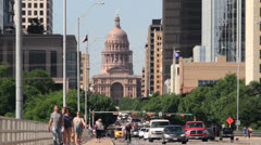 Traffic and people cross s congress avenue bridge, Austin Stock Footage