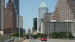 traffic crosses s congress avenue bridge with austin skyline in background - stock footage