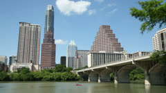 Stock Video Footage of canoeist on lady bird lake, austin skyline, texas, usa