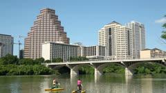 paddle bikes on lady bird lake, austin skyline, texas, usa - stock footage